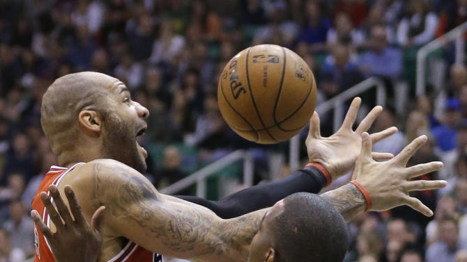 Chicago Bulls' Carlos Boozer (5) loses the ball as Utah Jazz's Paul Millsap (24) defends in the first quarter during an NBA basketball game Friday, Feb. 8, 2013, in Salt Lake City. (AP Photo/Rick Bowmer)