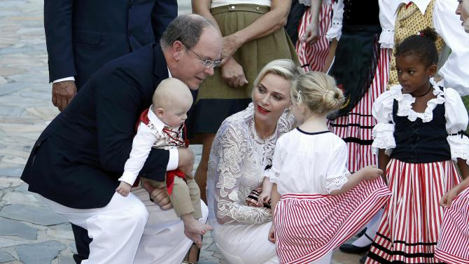 "Prince Albert II  and his wife Princess Charlene of Monaco arrive with their twins, Prince Jacques and Princess Gabriella, to take part in the traditional ""Pique Nique Monegasque"" (Monaco's picnic) in Monaco"