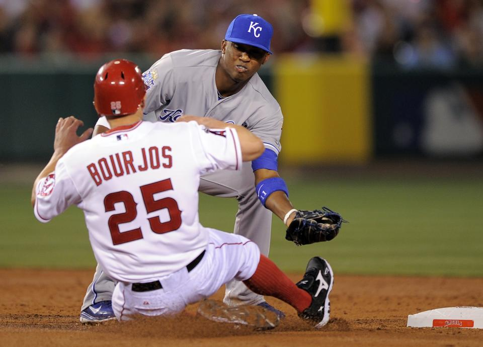 Los Angeles Angels' Peter Bourjos, left, is tagged out by Kansas City Royals shortstop Alcides Escobar while trying to steal second during the third inning of their baseball game on Friday, April 6, 2012, in Anaheim, Calif. (AP Photo/Mark J. Terrill)