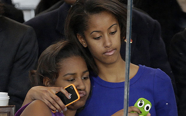 Sasha and Malia Obama at the Inaugural parade. (Gerald Herbert/AP)