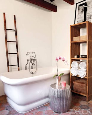 This master bathroom exudes rustic elegance. An antique bamboo ladder adds vertical interest, while a zinc garden stool adds glamour. Click the photo to tour the rest of actress Ellen Pompeo's Hollywood Hills home.