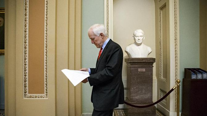 """Senate Majority Whip John Cornyn, R-Texas, heads to the chamber for a procedural vote on a funding bill for the Department of Homeland Security that has produced partisan gridlock in the first several weeks of the new Congress, at the Capitol in Washington, Monday evening, March 2, 2015. House Republicans want to use the measure to roll back President Obama's executive actions on immigration. Democrats have vowed to block any attempt to compromise on immigration and insist the Congress should approve a """"clean"""" bill funding DHS. (AP Photo/J. Scott Applewhite)"""