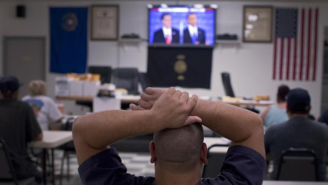 Bill Locke watches the presidential debate at the United Steelworkers Local 4856 Union Hall, Wednesday, Oct. 3, 2012, in Henderson, Nev. President Barack Obama and Republican presidential candidate Mitt Romney faced off, Wednesday night, in the first debate. (AP Photo/Julie Jacobson)