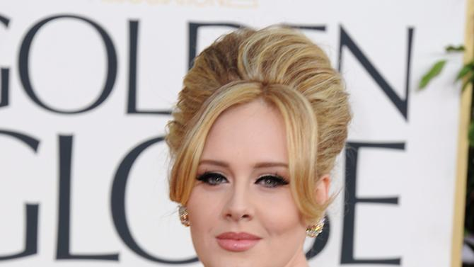 Singer Adele arrives at the 70th Annual Golden Globe Awards at the Beverly Hilton Hotel on Sunday Jan. 13, 2013, in Beverly Hills, Calif. (Photo by Jordan Strauss/Invision/AP)