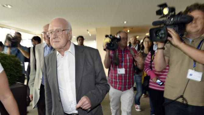 """British physicist Peter Higgs, left, arrives to hear about the latest update in the search for the Higgs boson at the European Organization for Nuclear Research (CERN) in Meyrin near Geneva, Switzerland, Wednesday, July 4, 2012. The head of the world's biggest atom smasher is claiming discovery of a new particle that he says is consistent with the long-sought Higgs boson known popularly as the """"God particle"""" which is believed to give all matter in the universe size and shape. (AP Photo/Keystone/Martial Trezzini)"""