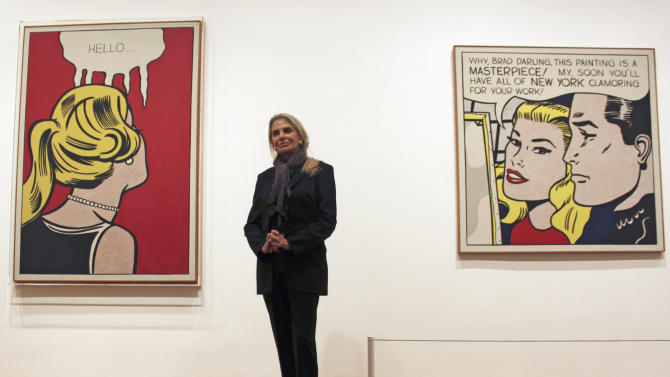 "In this May 11, 2012 photo, Dorothy Lichtenstein, widow of pop artist Roy Lichtenstein, stands between his artworks ""Cold Shoulder,"" left, and ""Masterpiece"" at the Art Institute of Chicago. The museum has opened ""Roy Lichtenstein: A Retrospective,"" which runs through Sept. 3 before traveling to Washington, London and Paris. (AP Photo/Caryn Rousseau)"