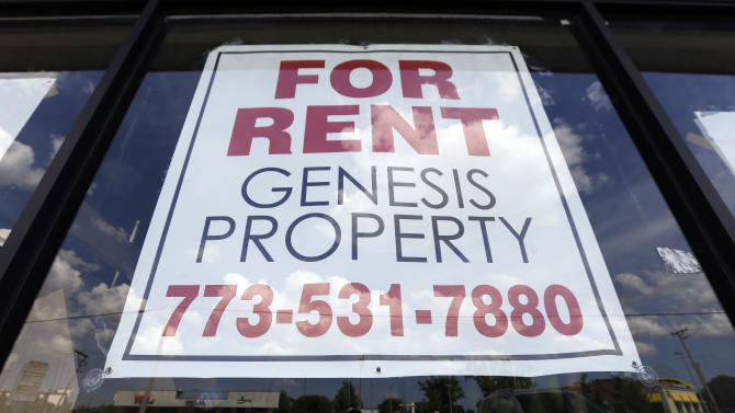 In this Sunday, June 16, 2013, photo, a rent sign is displayed outside building in Niles, Ill. Freddie Mac reports on mortgage rates for the first week of July on Thursday, July 11, 2013. (AP Photo/Nam Y. Huh)