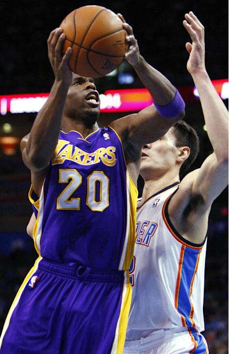 Los Angeles Lakers guard Jodie Meeks (20) goes up for a shot in front of Oklahoma City Thunder center Steven Adams during the first half of an NBA basketball game in Oklahoma City, Thursday, March 13,