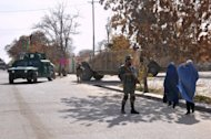Afghan policeman guards a security checkpoint in Ghazni. A passenger bus has collided with a fuel tanker in Afghanistan, killing 51 people and injuring several others, with women and children among the victims, officials say