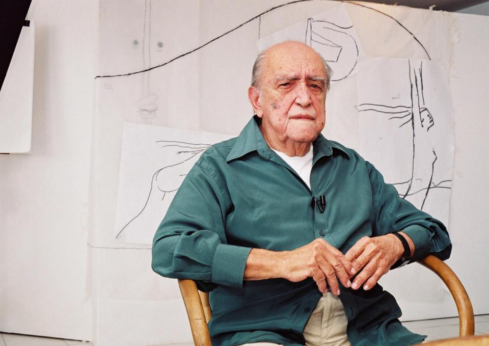 FILE - In this 2002 file photo, Brazilian architect Oscar Niemeyer sits during an interview in his office in Rio de Janeiro, Brazil. According to a hospital spokeswoman on Wednesday, Dec. 5, 2012, famed Brazilian architect Oscar Niemeyer has died at age 104. (AP Photo/Andre Luiz Mello, File)
