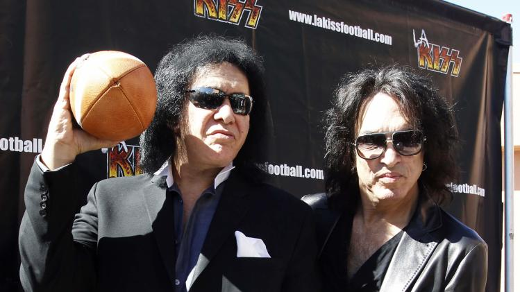 Musicians Gene Simmons and Paul Stanley of rock band KISS pose for photos at a news conference to announce their part-ownership of Arena Football League team, the Los Angeles Kiss, in Anaheim,