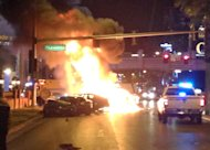 Smoke and flames billow from a burning vehicle following a shooting and multi-car accident on the Las Vegas Strip in Las Vegas early Thursday, Feb. 21, 2013. The Las Vegas Strip became a scene of deadly violence early Thursday when, authorities say, someone in a black Range Rover opened fire on a Maserati, sending it crashing into a taxi that burst into flames, leaving three people dead and at least six injured. (AP Photo/Erik Lackey)