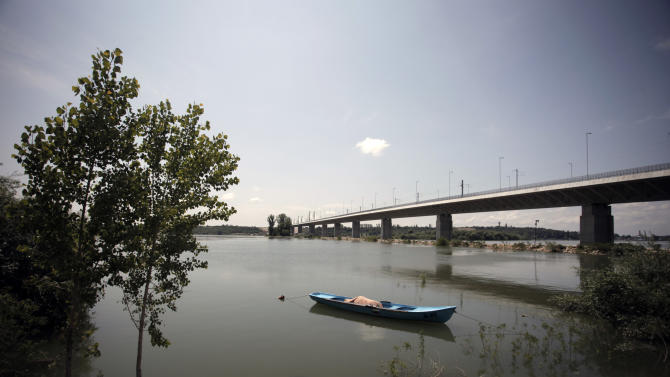 "This photo taken on Thursday, June 13, 2013 shows the new bridge between Bulgaria and Romania, in the town of Vidin, Bulgaria. The bridge is the second on the 500-kilometer stretch of the Danube River that forms the common border between the Balkan neighbors, and is touted as a key to boosting growth in one of Europe's poorest regions. But skeptics argue that dilapidated infrastructure on both sides of the river will turn it into ""a bridge to nowhere."" (AP Photo/Valentina Petrova)"