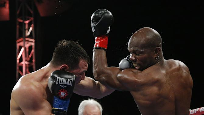 Timothy Bradley, right, and Ruslan Provodnikov, of Russia, trade punches in the fifth round of a WBO welterweight title boxing match in Carson, Calif., Saturday, March 16, 2013. Bradley won by unanimous decision after the 12th round. (AP Photo/Jae C. Hong)