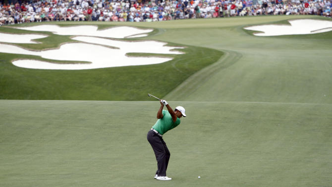 Tiger Woods hits his approach shot on the fifth hole during the second round of the Wells Fargo Championship golf tournament at Quail Hollow Club in Charlotte, N.C., Friday, May 4, 2012. (AP Photo/Nell Redmond)
