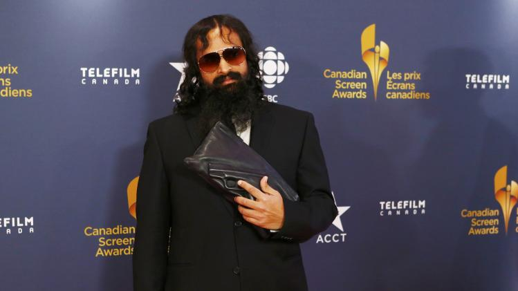 Actor Suresh John arrives on the red carpet at the 2014 Canadian Screen awards in Toronto