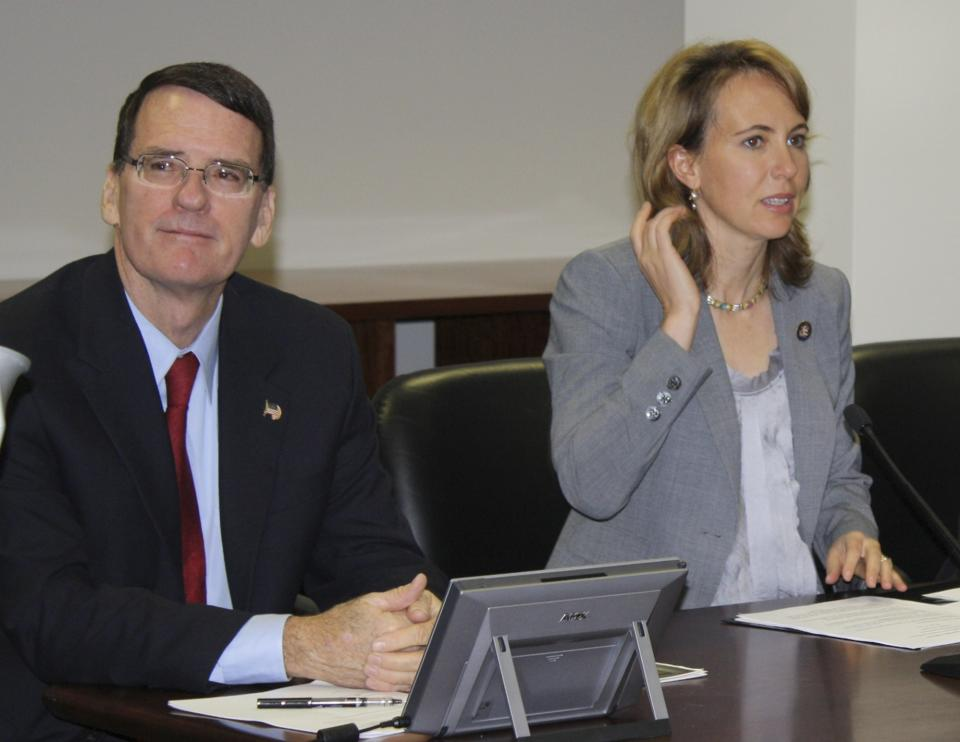 In this undated photo provided by the office of Rep. Gabrielle Giffords, Giffords, right, is shown with Arizona Federal District Judge John Roll. Giffords was critically wounded and Roll was killed during a shooting Saturday, Jan. 8, 2011 in Tucson, Ariz. (AP Photo/Office of Rep. Gabrielle Giffords)