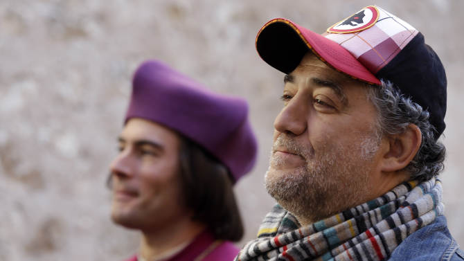 """In this photo taken Monday, Oct. 29, 2012, director Metin Huseyn waits for the start of the shooting of """"Borgia"""" tv series in Sermoneta, Italy.   The Italian economy may be struggling but the pan-European television series """"Borgia,"""" which is now filming its second season in Italy, is a thriving hit on the world market. Spanning the late Middle Ages to the early Renaissance period, the show follows the famous Borgia family's rise to power and subsequent domination of the Vatican and southern Europe's political landscape. A winning combination of sex, violence, faith, lust and betrayal, the primarily French-German production has been sold in 85 countries worldwide.  (AP Photo / Gregorio Borgia)"""