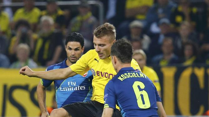 Dortmund's Immobile challenges Arsenal's Koscielny during Champions League soccer match in Dortmund