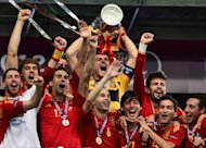 Spanish players celebrate with the trophy after winning the Euro 2012 football championships final match Spain vs Italy on July 1, at the Olympic Stadium in Kiev. By thrashing Italy 4-0 in Sunday's Euro 2012 final in Kiev, Spain staked a claim to the title of the greatest international team of all time