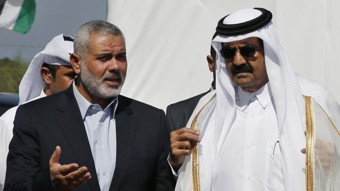 Emir of Qatar Sheikh Hamad bin Khalifa al-Thani, right, and Gaza's Hamas prime minister Ismail Haniyeh, left, arrive for the corner-stone laying ceremony for Hamad, a new residential neighborhood in Khan Younis, southern Gaza Strip Tuesday, Oct. 23, 2012. The emir of Qatar received a hero's welcome in Gaza on Tuesday, becoming the first head of state to visit the Palestinian territory since the Islamist militant Hamas seized control there in 2007. (AP Photo/Mohammed Salem, Pool)