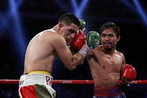Pacquiao of Philippines punches Rios of the U.S. during their WBO International 12-round welterweight boxing title fight at the Venetian Macao hotel in Macau