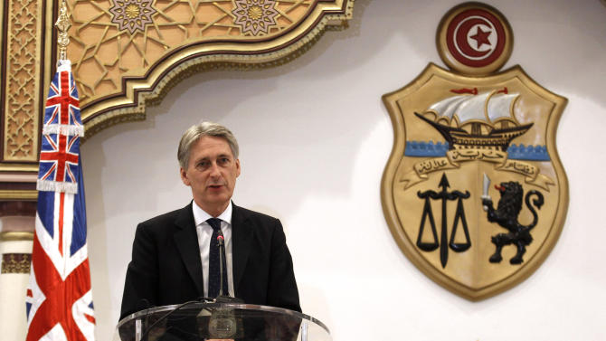 British Foreign Secretary Hammond speaks during a news conference in Tunis