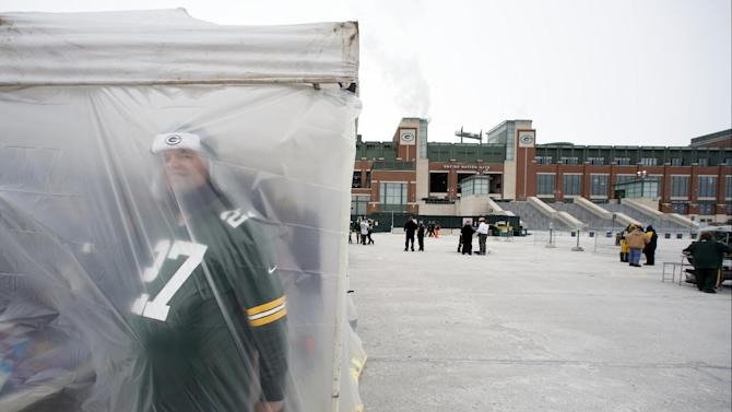 A Green Bay Packers fan looks through a tent as fans tailgate before an NFL wild-card playoff football game between the Green Bay Packers and the San Francisco 49ers, Sunday, Jan. 5, 2014, in Green Bay, Wis