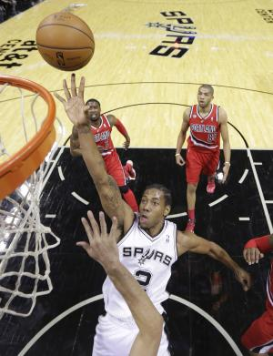San Antonio Spurs' Kawhi Leonard (2) scores against the Portland Trail Blazers during the first half of Game 5 of a Western Conference semifinal NBA basketball playoff series, Wednesday, May 14, 2014, in San Antonio. (AP Photo/Eric Gay)