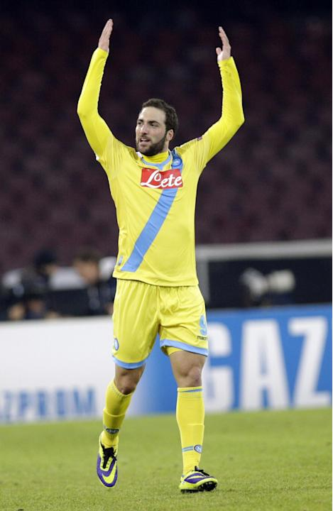 Napoli forward Gonzalo Higuan of Argentina celebrates after he scored during a Champions League, group F soccer match, at the Naples San Paolo stadium, Italy, Wednesday, Dec. 11, 2013