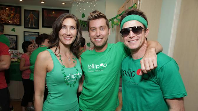 Lollipop Theater's Evelyn Iocolano, Lance Bass and Billy Bush at St. Patty's Day Slimdown benefiting the Lollipop Theatre Network held at Slimmons on Sunday, Mar., 17, 2013 in Beverly Hills, CA. (Photo by Eric Charbonneau/Invision for Lollipop Theatre Network/AP Images)