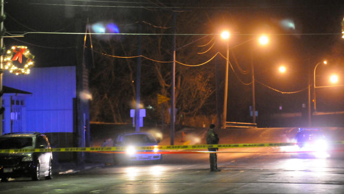 Crime scene tape crosses Main Street between Third Avenue South and Fifth Avenue South early Friday, Nov. 30, 2012, in Cold Spring, Minn., after a Cold Spring police officer was fatally shot while conducting a routine check near a bar. (AP Photo/The St. Cloud Times, Eric Stromgren) NO SALES