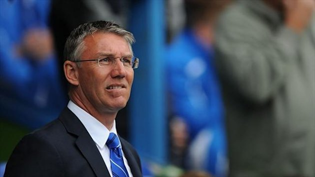 Reading manager Nigel Adkins has made his third summer signing