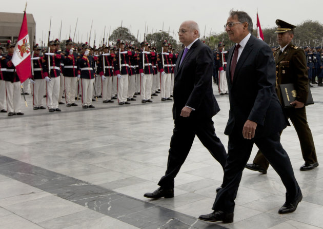 U.S. Defense Secretary Leon Panetta, right, walks with Peru's Defense Minister Pedro Cateriano past the honor guard during a ceremony at army headquarters in Lima, Peru, Saturday, Oct. 6, 2012. Panetta is in Lima on an official visit for one day. (AP Photo/Martin Mejia)