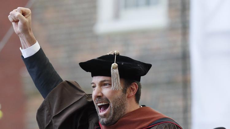 Actor and director Ben Affleck raises his fist after receiving an honorary degree at Brown University's commencement in Providence, R.I., Sunday, May 26, 2013. (AP Photo/Michael Dwyer)