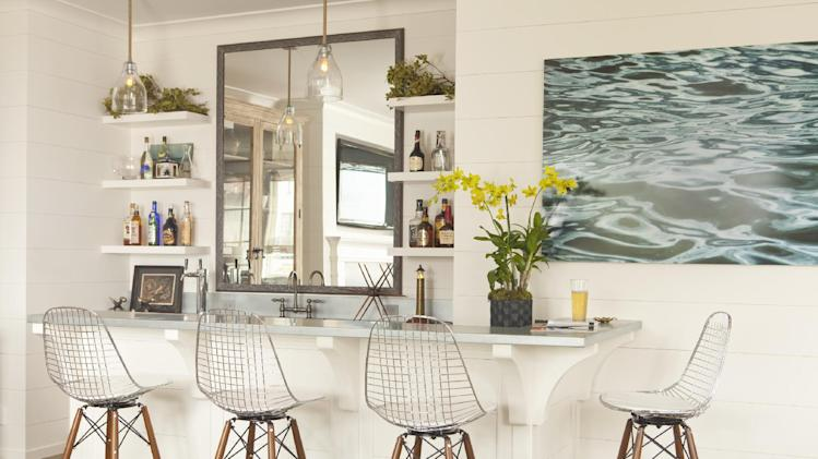 This interior design image released by Lucas Studio, Inc. shows a bar with a beach inspired design. The sun-drenched colors and windswept beachfront textures of summer provide ample inspiration for indoor decorating. Done wrong, a summer-inspired interior can be a tacky, overly tropical disaster. But with a light touch and careful choices, summer can provide ideas for an interior you'll love all year long. (AP Photo/Lucas Studio, Inc., Karyn Millet)