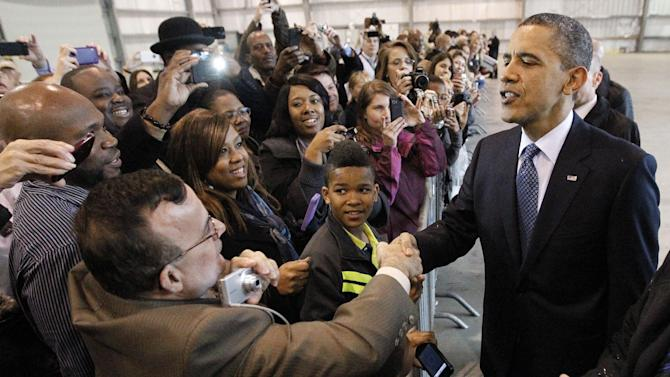 President Barack Obama greets supporters inside a hanger during his arrival at Ellington Airport, Friday, March, 9, 2012, in Houston. (AP Photo/Pablo Martinez Monsivais)
