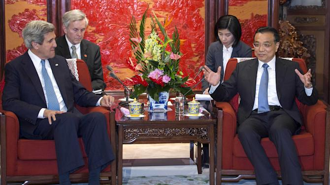 U.S. Secretary of State John Kerry, left, listens to Chinese Premier Liu Keqiang during their meeting at the Zhongnanhai Leadership Compound Saturday, April 13, 2013 in Beijing. The question of how Washington can persuade Beijing to exert real pressure on North Korean leader Kim Jong Un's unpredictable regime is front and center as Kerry meets Saturday with Chinese leaders in Beijing. (AP Photo/Paul J. Richards, Pool)