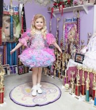 Eden Wood, 6, in her room among her trophies