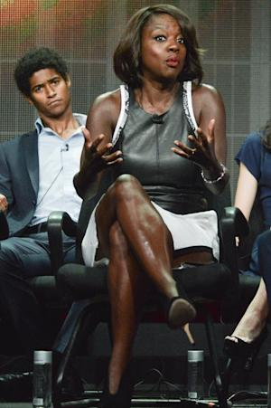 """Viola Davis, right and Alfred Enoch speaks onstage during the """"How to Get Away with Murder"""" panel at the Disney/ABC Television Group 2014 Summer TCA held at the Beverly Hilton Hotel on Tuesday, July 15, 2014, in Beverly Hills, Calif. (Photo by Richard Shotwell/Invision/AP)"""
