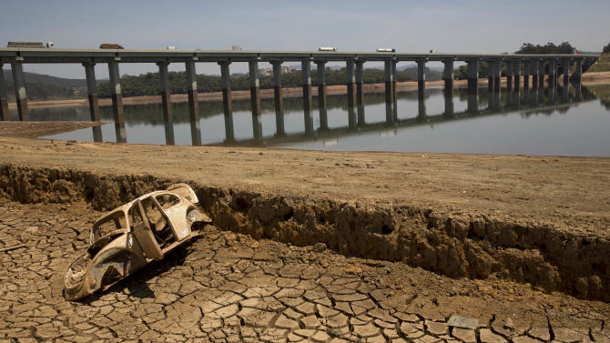FILE - In this Oct. 10, 2014 file photo, the frame of a car sits on the cracked earth at the bottom of the Atibainha dam, part of the Cantareira System responsible for providing water to the Sao Paulo metropolitan area, in Nazare Paulista, Brazil. Halfway through the rainy season, the key reservoir for the hemisphere's largest city, the Cantareira water system, holds just 6 percent of its capacity, and experts warned Friday, Jan. 16, 2015 that authorities must take urgent steps to prevent the worst drought here in more than 80 years from drying it out. (AP Photo/Andre Penner, File)