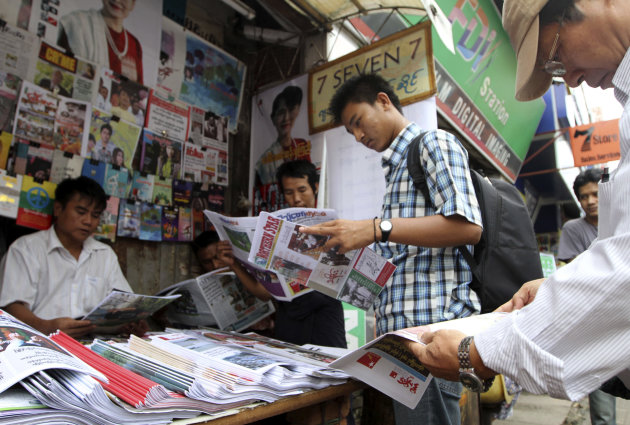 Customers buy local weekly journals at a roadside shop in Yangon, Myanmar, Monday, Aug. 20, 2012. Myanmar&#39;s government said Monday it was abolishing the harsh practice of directly censoring the country&#39;s media, the most dramatic move yet toward allowing freedom of expression in the long-repressed nation. Under the new rules, journalists will no longer have to submit their work to state censors before publication as they for almost half a century. (AP Photo/Khin Maung Win)