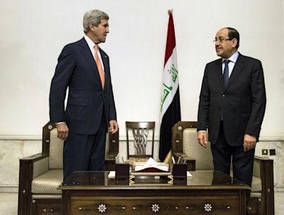 U.S. Secretary of State John Kerry, left, meets with Iraqi Prime Minister Nouri al-Maliki, right, at the Prime Minister's office in Baghdad on Monday,...