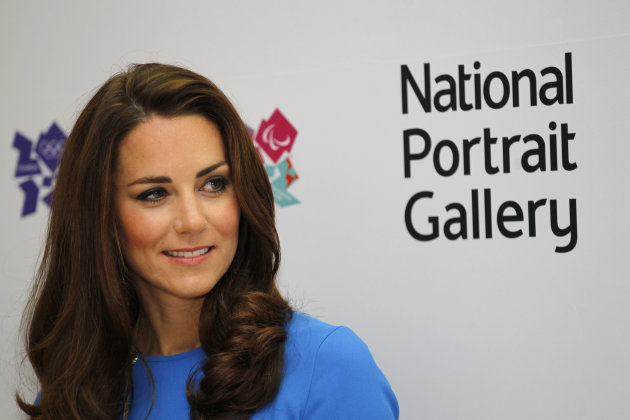 Kate, Duchess of Cambridge reacts as she listens to a speech during her visit to 'Road to 2012 : Aiming High' exhibition at the National Portrait Gallery in London, Thursday, July 19, 2012. The Duchess of Cambridge is the Patron of the National Portrait Gallery. The exhibition showcase commissioned photographs documenting the preparations for London 2012 Olympics. (AP Photo/Sang Tan, Pool)