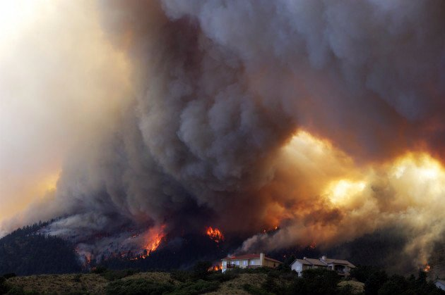 The drought and heat combined to cause some of the most destructive wildfires in Colorado's history. At one point a half-dozen blazes were raging across the state, including a patch near Colorado Springs. (Gaylon Wampler/AP Photo)