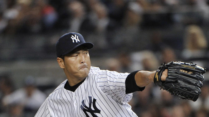 New York Yankees' Hiroki Kuroda delivers a pitch during the first inning of Game 3 of the Yankees' American League division baseball series against the Baltimore Orioles on Wednesday, Oct. 10, 2012, in New York. (AP Photo/Bill Kostroun)