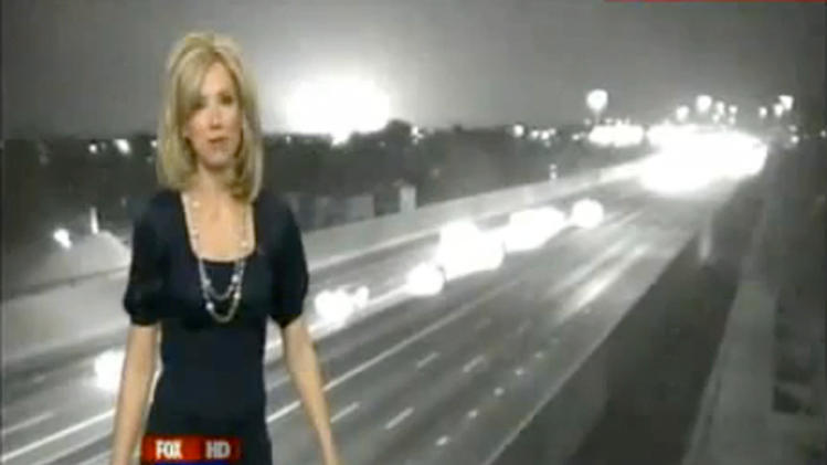 In this Thursday, March 8, 2012 still frame from video provided by Phoenix Fox 10 Television, an unexplained bright flash of light appears over the shoulder of FOX 10 television news reporter Andrea Robinson during a live broadcast in Phoenix. (AP Photo/Fox 10 News Phoenix)