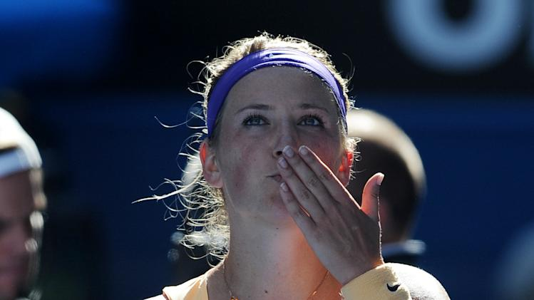 Victoria Azarenka of Belarus celebrates after defeating Sloane Stephens of the US in their semifinal match at the Australian Open tennis championship in Melbourne, Australia, Thursday, Jan. 24, 2013. (AP Photo/Andrew Brownbill)