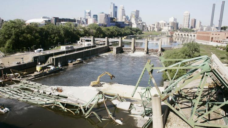FILE - In this Aug. 31, 2007 file photo, the Minneapolis skyline is shown in the distance in this view of the Interstate 35W bridge which collapsed into the Mississippi River, Aug. 1, 2007, killing 13 people and injuring more than 100 others. Minnesota's legal battle over the collapsed bridge has ended with an $8.9 million settlement involving a California design firm after a check from Jacobs Engineering Group arrived Tuesday, Nov. 13, 2012 at the Minnesota Department of Transportation. (AP Photo/Jim Mone, File)