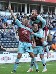 Charlie Austin, left, is mobbed by his team-mates after grabbing Burnley's winner late on